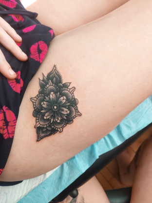 Isolation Tattoos Inc. - Tatouage