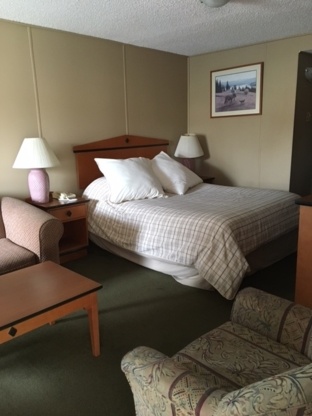 Olympia Lodge - Motels - 403-288-4461