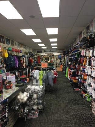 Doug's Sports Ltd - Sporting Goods Stores - 403-327-5751