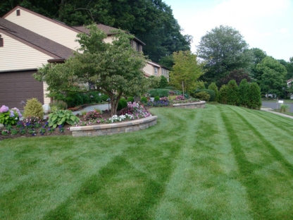 Impressions Lawn Care - Lawn Maintenance - 226-979-4246